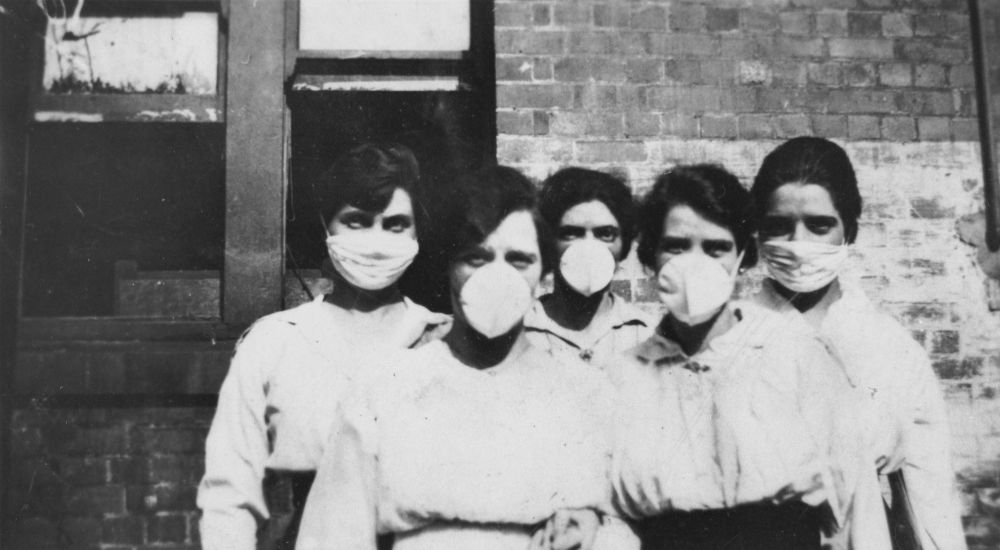 Women wearing surgical masks during the influenza epidemic, Brisbane, 1919. Credit: John Oxley Library, State Library of Queensland, 1919